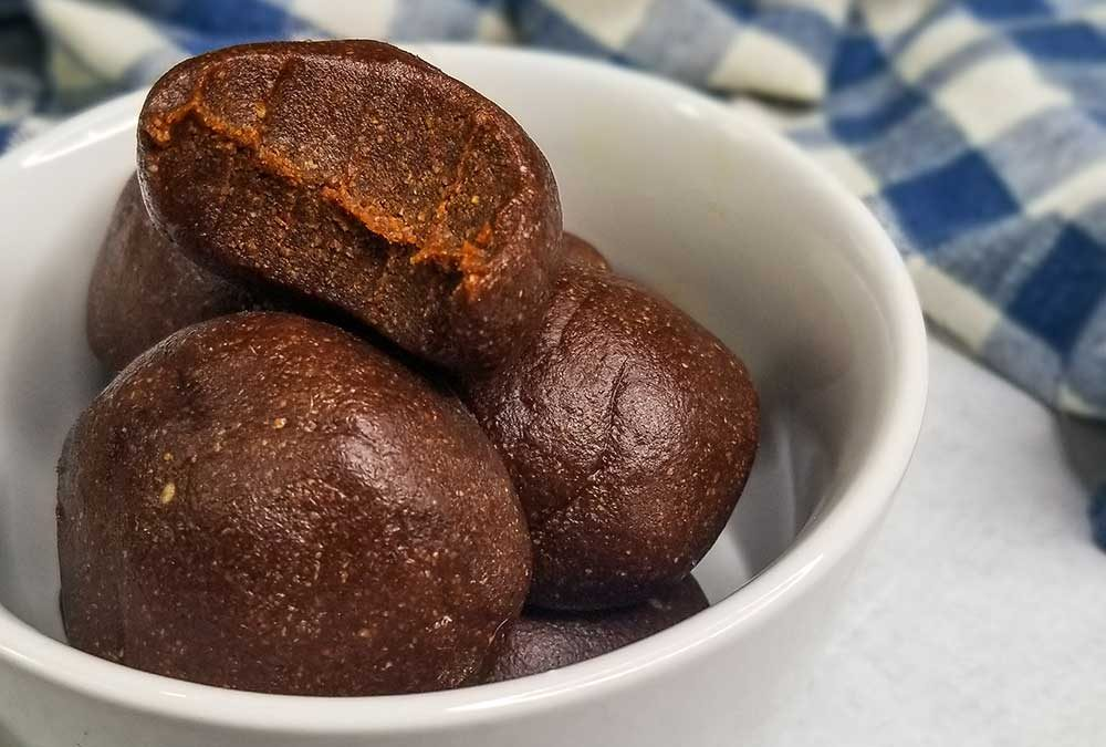 ginger molasses cookie dough bites in a bowl ready to serve