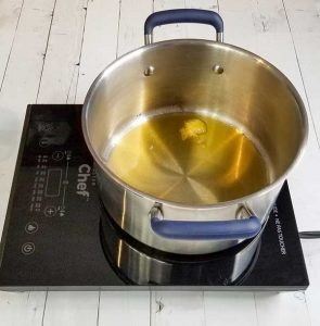 coconut oil in pot on stove