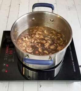 stock added to pot on stove