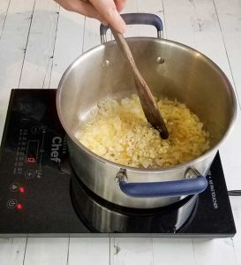 sautéing onions in pot on stove
