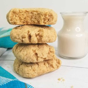 image of stacked cookies beside glass of dairy free milk